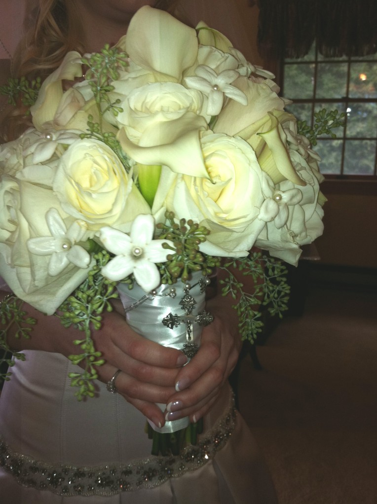 "The bride's gorgeous bouquet, with something ""old"" -- my family's antique cross from the 1900s (I wore it for my wedding, too!)"