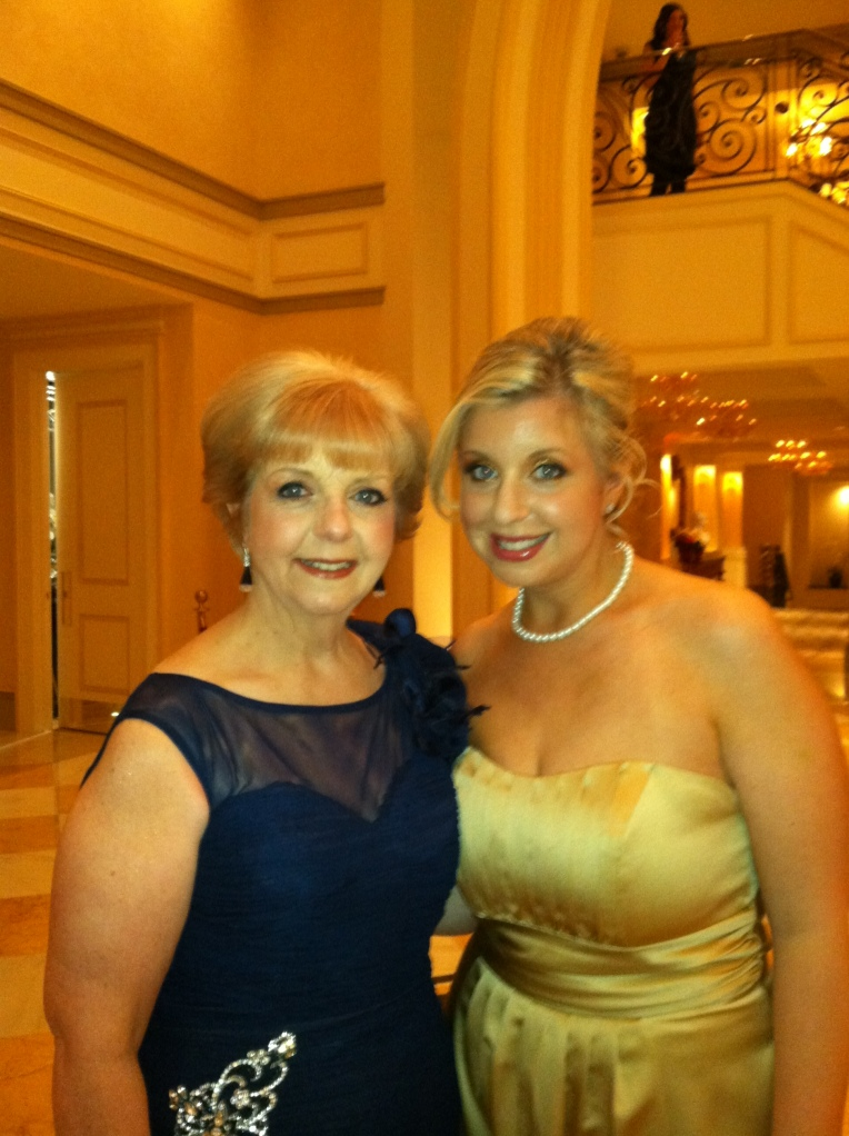 The original mom a la mode, looking stunning in a navy gown from East West Bridals