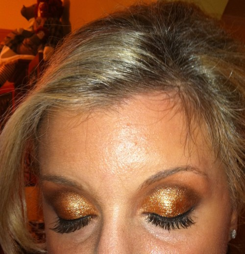 TIA Cosmetics Executive Makeup Artist, Bettina, created a sparkly eyelid to complement our gold dresses. Perfectly festive for a Christmas wedding.